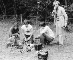 group of four around transmitter and car batteries