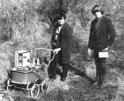 two characters in a field with a pram